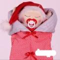 عروسک نوزاد قرمز